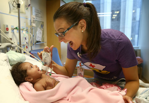 Baby with NICU Caregiver